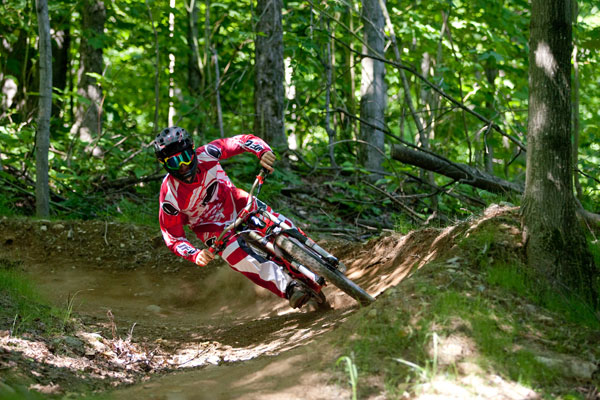 "Mountain biking at Ski Bromont Ski Bromont offers 21 downhill mountain bike trails accessible by chairlift including ""La Grande Douce"", rated as an ""easy"" mountain bike trail, perfect for beginners. © Ski Bromont"