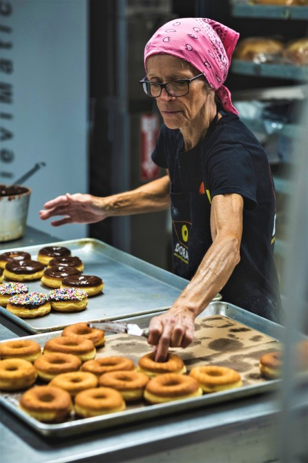 Donut Chef at Work - Johane: Legendary Johane begins her shift at midnight, hand making an average of 1,000 donuts per day. She prepares the dough, cuts, bakes, glazes, stuffs and sugars each donut by hand - all of our glazes and fillings are also homemade, from scratch!