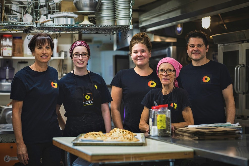 Dora's Team: The Dora team is comprised of a dozen employees - a small group is produced in this photo, including the donut chef, the pastry chef, the kitchen chef and the owner.